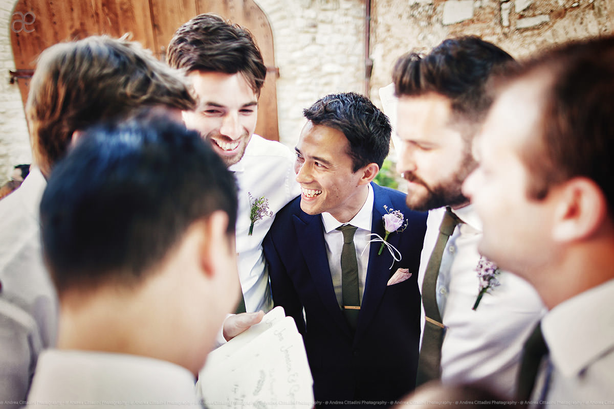 happy groom with friends