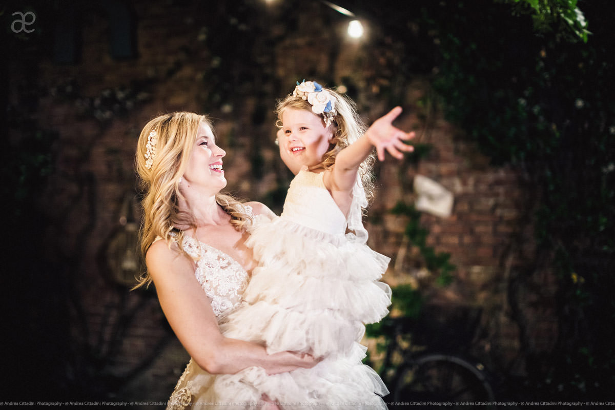 happy flower girl with bride